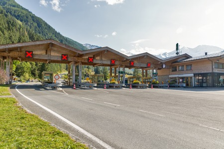 GROSSGLOCKNER, AUSTRIA - SEPTEMBER 23, 2017: Grossglockner High Alpine Road pay toll checkpoint close to Wildpark Ferleiten in Austrian Alps. It is the highest surfaced mountain pass road in Austria.