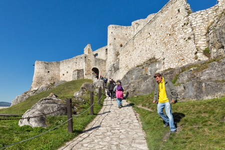 SPISSKE PODHRADIE, SLOVAKIA - OCTOBER 01, 2017: Unrecognized people visit Spis Castle courtyard. Spissky hrad, National Cultural Monument UNESCO, is one of the largest castles in Central Europe. Editorial