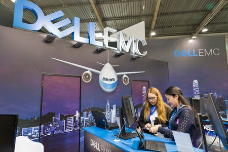 KIEV, UKRAINE - OCTOBER 07, 2017: Unrecognized presenters work on Dell Emc, an American data storage company booth during CEE 2017, the largest electronics trade show of Ukraine in KyivExpoPlaza EC.