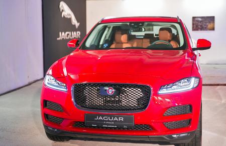 KIEV, UKRAINE - OCTOBER 27, 2017: Red modern Jaguar F-PACE on the art exhibition