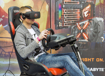 virtual reality simulator: KIEV, UKRAINE - OCTOBER 07, 2017: People visit Asus, a Taiwan based international computer company booth during CEE 2017, the largest electronics trade show of Ukraine in ExpoPlaza Exhibition Center. Editorial