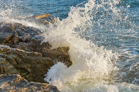 Stormy rocky beach in Istria, Croatia. Solaris summer resort, Adriatic Sea, Lanterna peninsula. The wave breaks down against stone.