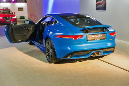KIEV, UKRAINE - OCTOBER 27, 2017: Blue modern Jaguar F-TYPE with opened door on the art exhibition Jaguar The Art of Performance in Business Center Toronto. Editorial