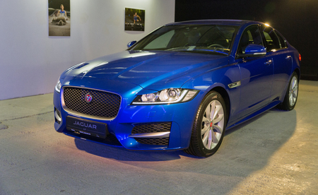 KIEV, UKRAINE - OCTOBER 27, 2017: Blue modern Jaguar XF on the art exhibition Jaguar The Art of Performance in Business Center Toronto. Editorial