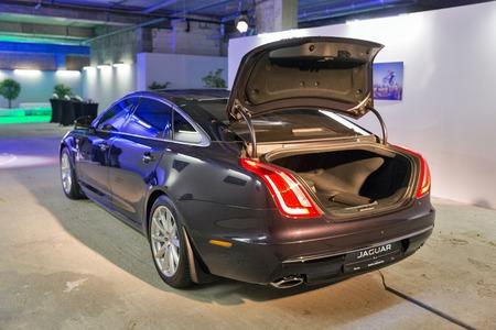 KIEV, UKRAINE - OCTOBER 27, 2017: Black modern Jaguar XJ car on the art exhibition Jaguar The Art of Performance in Business Center Toronto.