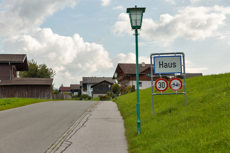 Road sign of Alpine village Haus in Styria, Austria.