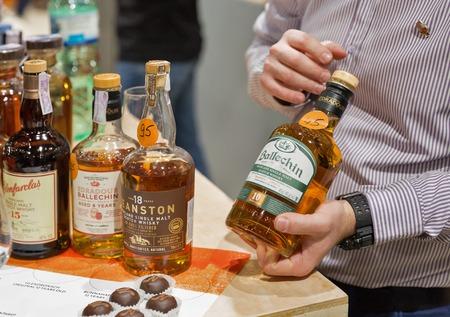 KIEV, UKRAINE - NOVEMBER 25, 2017: Unrecognized sommelier presents Ballechin Single Malt Scotch Highland Whisky at 3rd Ukrainian Whisky Dram Festival in Parkovy Exhibition Center.