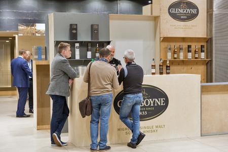 KIEV, UKRAINE - NOVEMBER 25, 2017: Unrecognized people visits Glengoyne Single Malt Scotch Whisky Highland distillery booth at 3rd Ukrainian Whisky Dram Festival in Parkovy Exhibition Center. Editorial