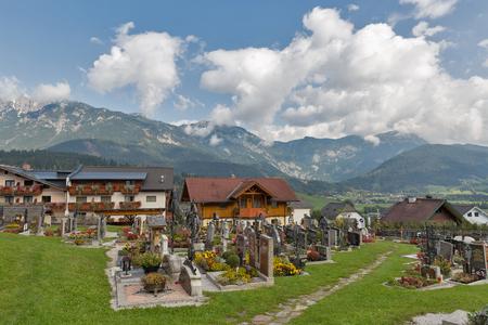 HAUS, AUSTRIA - SEPTEMBER 24, 2017: Old rural Alpine cemetery close to Saint John the Baptist church. Haus village is a small winter resort located in Styria, Austria.
