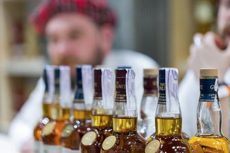 KIEV, UKRAINE - NOVEMBER 25, 2017: Glenlivet Single Malt Scotch Whisky Highland distillery booth at 3rd Ukrainian Whisky Dram Festival in Parkovy Exhibition Center. Editorial