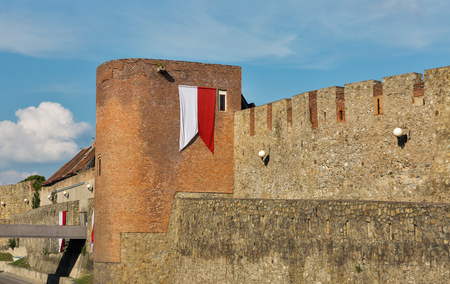 Ancient city walls with Bratislava city flag, Slovakia.