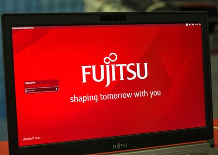 KIEV, UKRAINE - OCTOBER 07, 2017: Logo Fujitsu closeup, a Japanese multinational information technology equipment and services company booth at CEE 2017, electronics trade show in KyivExpoPlaza EC.