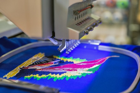 Professional machine for applying embroidery on different tissues closeup Stock Photo