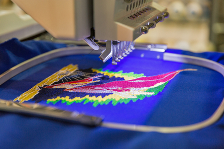 Professional machine for applying embroidery on different tissues closeup Stockfoto
