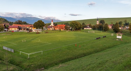Summer townscape of Liptovsky Trnovec village with football stadium in Slovakia.