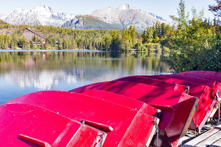 Red flipped over recreational boats on Strbske Lake shore in Slovakia. It is a favorite ski, tourist, and health resort in the High Tatras.
