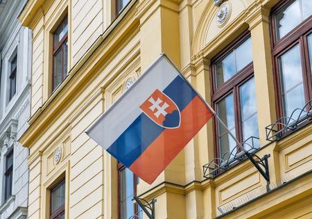 Flag of Slovakia outdoor on building facade in Banska Bystrica.