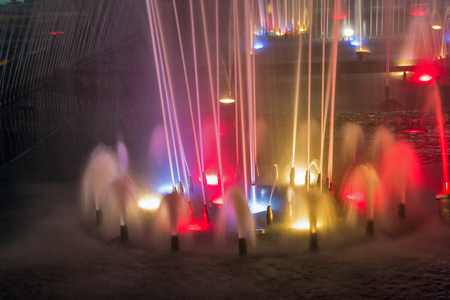 Singing fountain closeup in Kosice Old Town on Hlavna or Main Square at night, Slovakia.