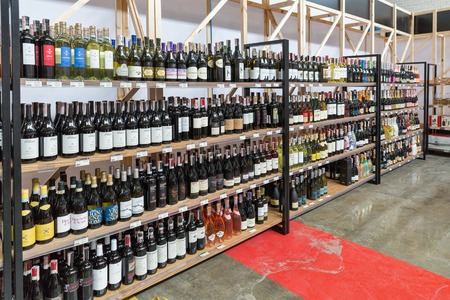 KIEV, UKRAINE - JUNE 02, 2018: Store shelves with wine and sparkling wine at Kyiv Wine Festival. 77 winemakers from around the world took part in the big festival organized by Good Wine company.