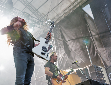 KIEV, UKRAINE - JULY 04, 2018: Dutch symphonic metal rock band Epica and its bass guitarist Rob van der Loo performs live at the Atlas Weekend Festival in National Expocenter.