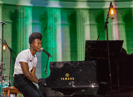 KIEV, UKRAINE - JULY 06, 2018: Benjamin Clementine, English artist, poet, vocalist, composer and musician performs live at the Atlas Weekend Festival in National Expocenter.