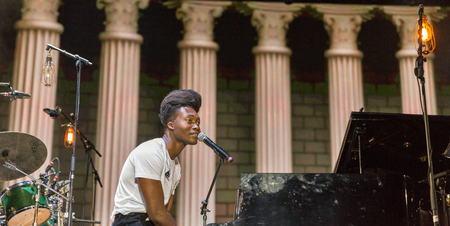 KIEV, UKRAINE - JULY 06, 2018: Benjamin Clementine, English artist, poet, vocalist, composer and musician performs live at the Atlas Weekend Festival in National Expocenter. Editorial