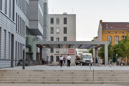 BERLIN, GERMANY - JULY 13, 2018: Charite Hospital main building emergency entrance. It is Europes largest university clinic and one of Germanys most research intensive medical institutions.