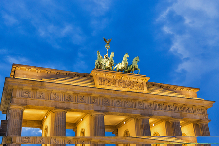 The Brandenburg Gate upper fragment against dramatic sky in Berlin at sunset, Germany