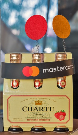 KIEV, UKRAINE - JULY 08, 2018: Artwinery Charte sparkling wine bottles with Mastercard cup at Atlas Weekend Festival in National Expocenter. Atlas Weekend is a popular annual music and arts festival. Editorial