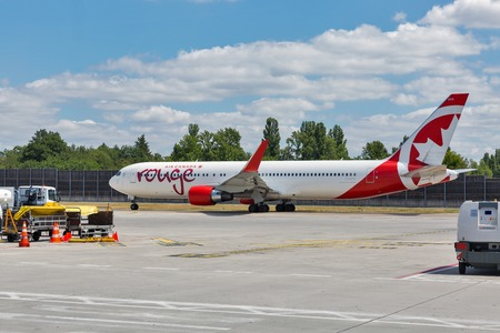 BERLIN, GERMANY - JULY 15, 2018: Air Canada Boeing 767-300ER passenger plane in Rouge colours at Tegel Otto Lilienthal international airport. Rouge is a low-cost airline and subsidiary of Air Canada.
