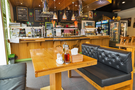 KIEV, UKRAINE - OCTOBER 04, 2017: Interior of Pasta Mia restaurant with wooden furniture. Pasta Mia branded restaurants serve classic Italian dishes like at pasteriya at OKKO fuel stations. Редакционное
