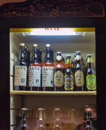 KIEV, UKRAINE - AUGUST 03, 2017: Fridge with different Lithuanian beers closeup. Beer is the most common alcoholic beverage in Lithuania, it has a long farmhouse beer tradition from 11th century. Редакционное