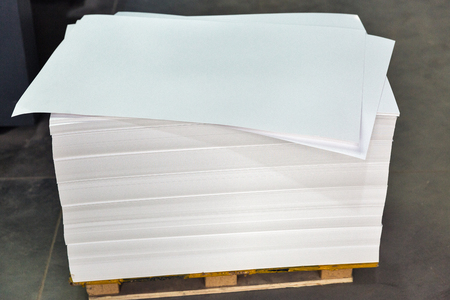 stack of blank sheets of white cardboard for the printing industry closeup