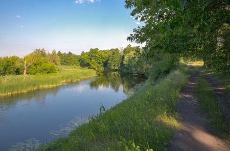 Summer river Ros landscape with rural road in , Ukraine