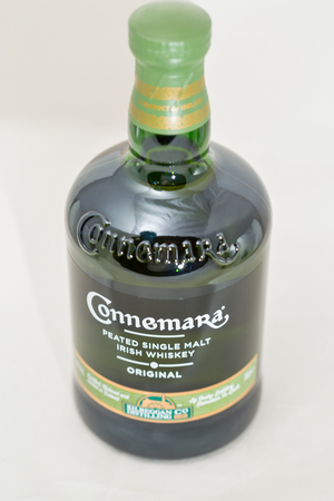 KIEV, UKRAINE - DECEMBER 25, 2018: Connemara peated single malt Irish Whisky bottle closeup. The Kilbeggan distillery was founded in 1757.