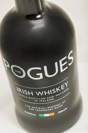 KIEV, UKRAINE - FEBRUARY 17, 2019: The Pogues blended Irish Whiskey triple distilled and matured bottle closeup. It is the official whiskey of legendary band The Pogues. Editorial