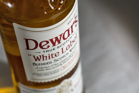 KIEV, UKRAINE - NOVEMBER 11, 2018: Dewars White Label blended Scotch Whisky closeup. Dewars whiskies have won more than 400 awards and medals in over 20 countries.