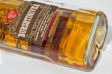 KIEV, UKRAINE - NOVEMBER 11, 2018: Burshtinivka Ukrainian vodka with amber and succinic acid bottle closeup. Editorial