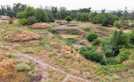 Summer landscape with ancient Scythian mounds and stone idols of Khortytsia island, Ukraine