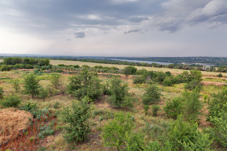 Thunder sky over summer landscape over Khortytsia island and Dnieper river, Ukraine