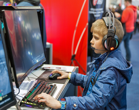 KYIV, UKRAINE - APRIL 06, 2019: Young boy visit MSI, a Taiwan based information technology corporation booth during CEE 2019, the largest electronics trade show of Ukraine in Tetra Pack EC.