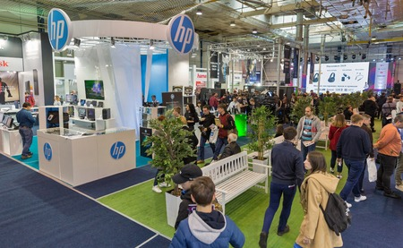 KYIV, UKRAINE - APRIL 06, 2019: People visit Hewlett-Packard booth, American multinational information technology company during CEE 2019, largest consumer electronics trade show in Tetra Pack EC.
