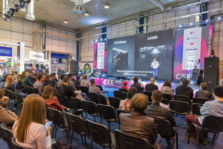 KYIV, UKRAINE - APRIL 06, 2019: People visit presentation of Sony professional photographic cameras during CEE 2019, the largest consumer electronics trade show of Ukraine in Tetra Pack EC.
