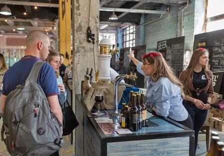 KYIV, UKRAINE - MAY 20, 2018: People enjoy craft beer during Kyiv Beer Festival vol. 3 in Art Zavod Platforma. About 300 unique varieties of craft beer were presented here. Redakční