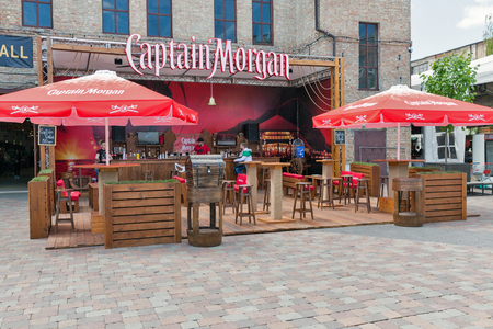 KYIV, UKRAINE - MAY 20, 2018: Captain Morgan Jamaica rum outdoor bar waiting for visitors at Kyiv Beer Festival in Art Zavod Platforma. It is a brand of rum produced by alcohol conglomerate Diageo.
