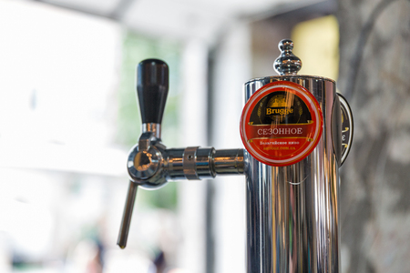 KYIV, UKRAINE - MAY 20, 2018: Brugge Brewery craft beer tap closeup during Kyiv Beer Festival vol. 3 in Art Zavod Platforma. About 300 unique varieties of craft beer were presented here. Redakční