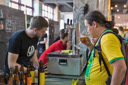KYIV, UKRAINE - MAY 20, 2018: People enjoy craft beer during Kyiv Beer Festival vol. 3 in Art Zavod Platforma. About 300 unique varieties of craft beer were presented here. Redakční