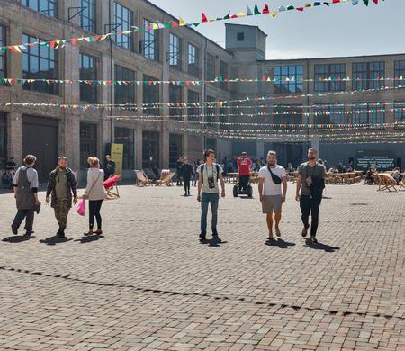 KYIV, UKRAINE - MAY 20, 2018: People visit craft Kyiv Beer Festival vol. 3 in Art Zavod Platforma. About 300 unique varieties of craft beer were presented here.
