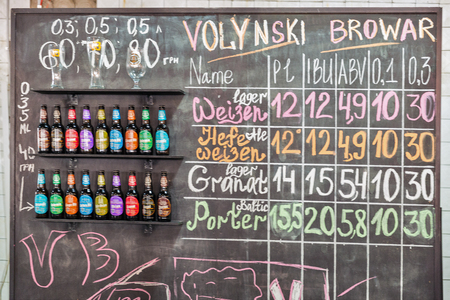 KYIV, UKRAINE - MAY 20, 2018: Volynski Browar Brewery craft beer price display board at Kyiv Beer Festival vol. 3 in Art Zavod Platforma. About 300 unique varieties of craft beer were presented here.