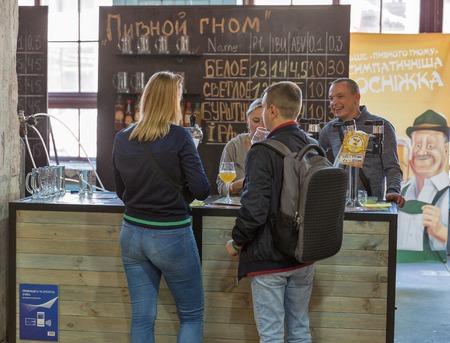 KYIV, UKRAINE - MAY 20, 2018: People enjoy Beer Gnome Brewery craft beer during Kyiv Beer Festival vol. 3 in Art Zavod Platforma. About 300 unique varieties of craft beer were presented here.